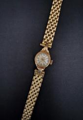 Montre-bracelet de dame en or jaune 18k bracelet maille grain de riz